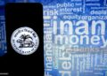 INDIA - 2019/10/15: In this photo illustration Reserve Bank of India logo seen display on a smartphone. (Photo Illustration by Avishek Das/SOPA Images/LightRocket via Getty Images)